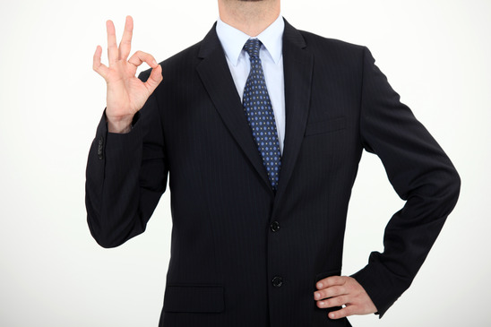 Businessman making thumbs-up gesture