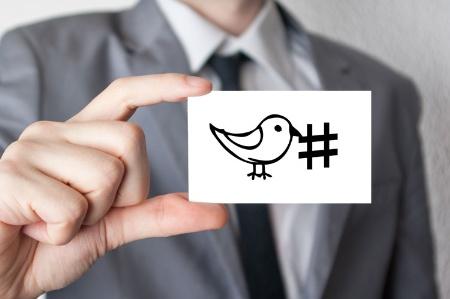 man-holding-twitter-bird-hashtag-business-car_450